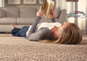 Woman reading on a carpet